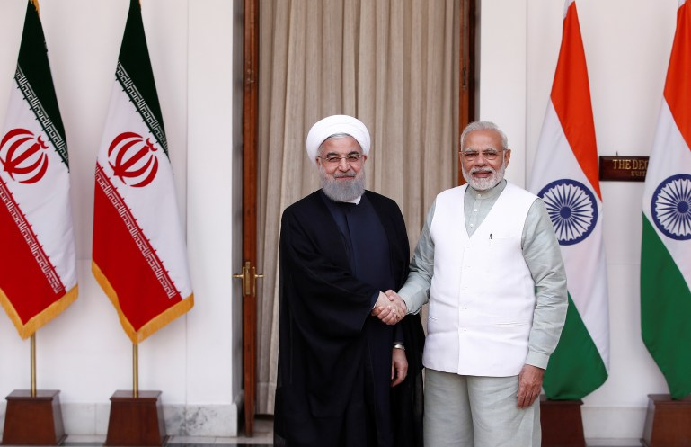 Iranian President Hassan Rouhani shakes hands with India's Prime Minister Narendra Modi (R) during a photo opportunity ahead of their meeting at Hyderabad House in New Delhi
