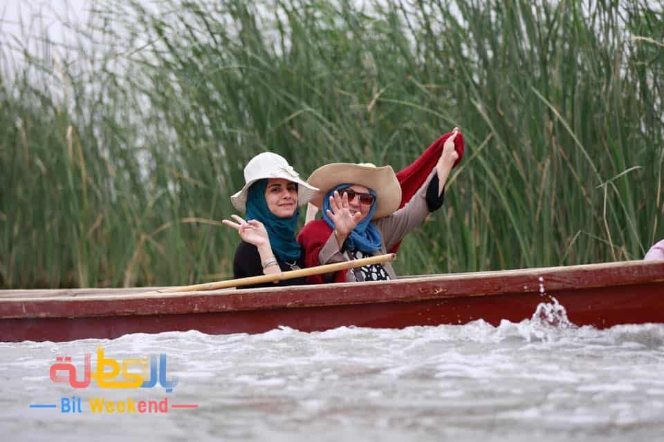 Startups in iraq - Two women riding a canoe