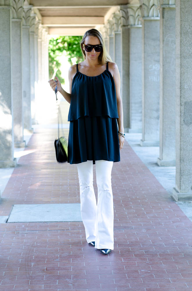 Style of the day - if you like it wear it! Love this combination of a wide dress over some flared jeans.