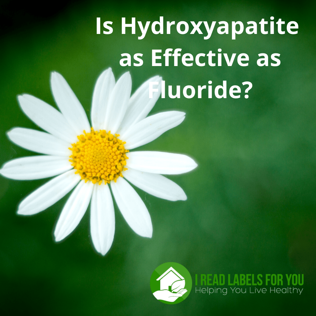 Is Hydroxyapatite as Effective as Fluoride in toothpaste. A picture of a daisy on the green background.