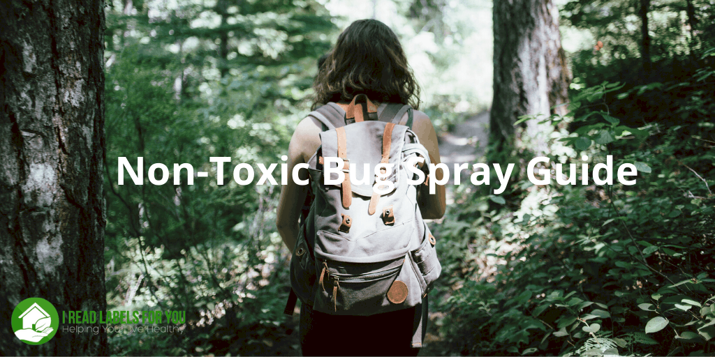 Non-Toxic Bug Spray Guide. A photo of a girl hiking in the forest sprayed with the best bug repellent for protection.