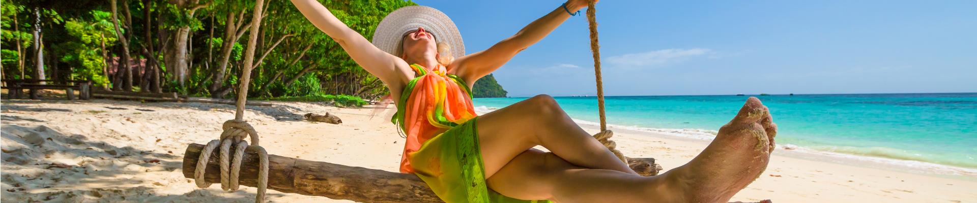 bigstock-Woman-swing-on-the-beach-117102596x