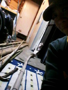 Here is me getting ready to split the bamboo in my garage. The carpet is there to protect the blade in case I hit the chisel so hard it lands on the concrete floor.