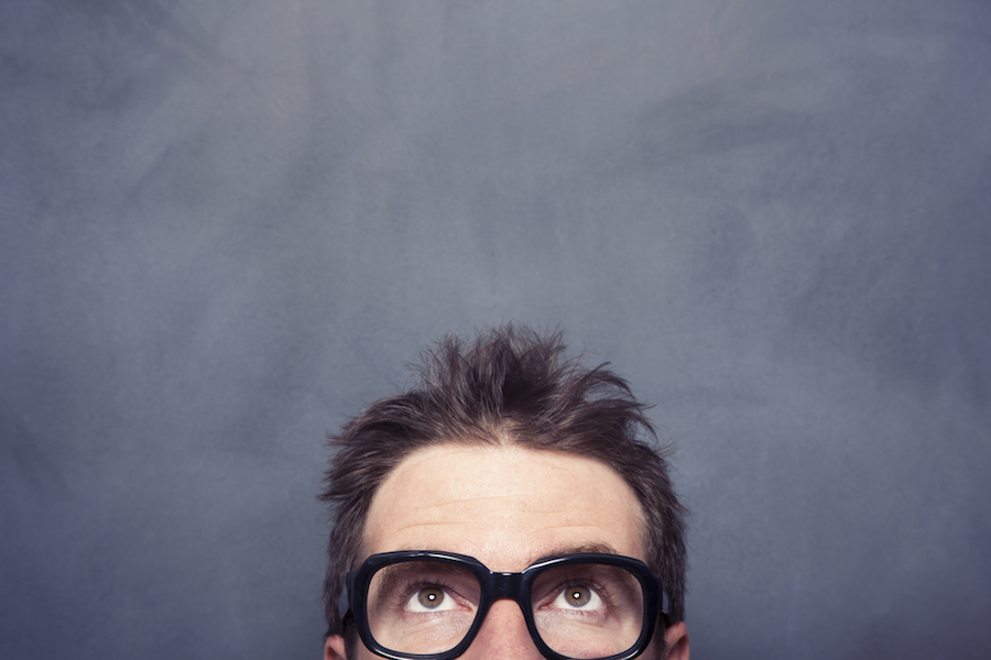 man with glasses looking up