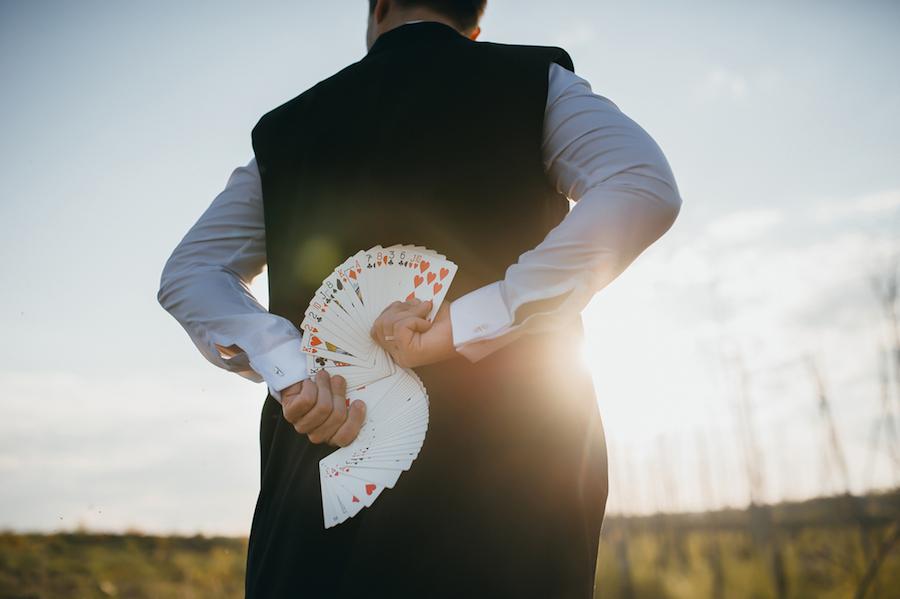 magician doing a card trick