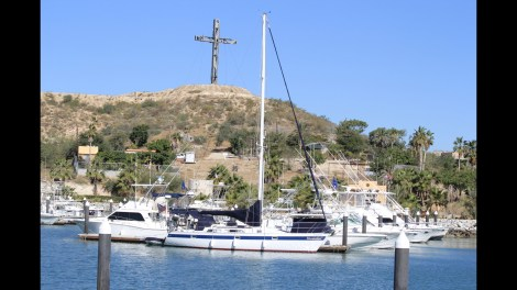 Carolee and Jay's boat with the iconic Puerto Los Cabos Cross
