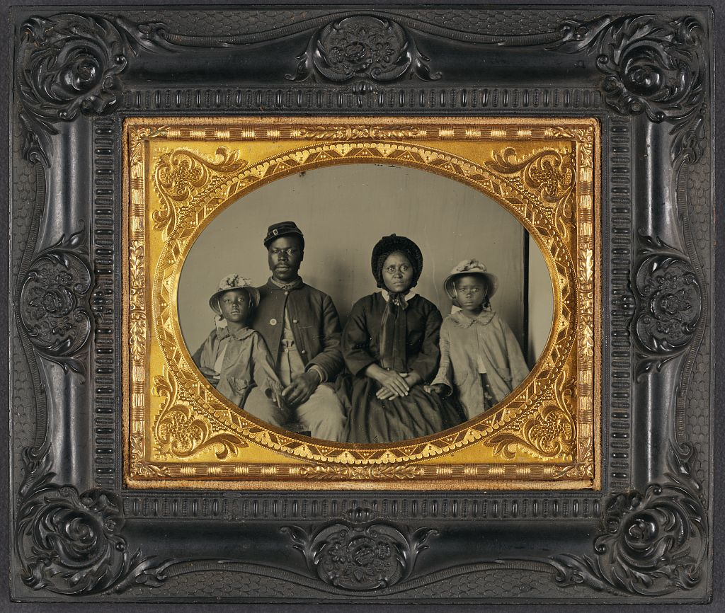 An African-American soldier photographed with his wife and daughters (Library of Congress)
