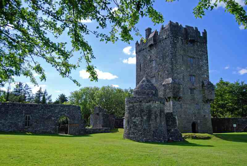 A view of Aughnanure Castle, front facing on a sunny day.
