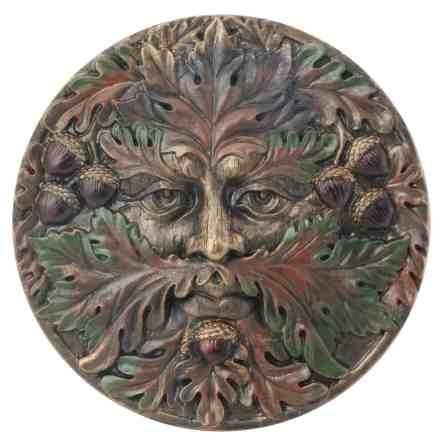 A Green Man face plaque