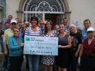 Hilary Fitzgibbon and Deirdre Joyce of the Irish Club of Luxembourg present a cheque to Stemm vun der Stroos
