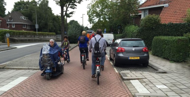 IMAGE: Separate cycling paths and service streets with limited car access also enable people with mobility challenges to move about their city.