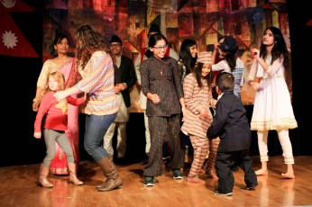 Students, faculty, and community members dance on stage during Taste of Nepal, Saturday at Bruce Pitman Center.