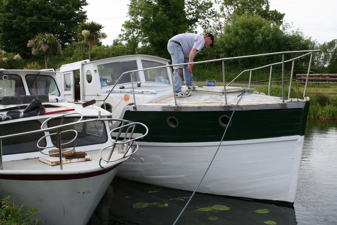 The owner hard at work on a hot day. I know they're a lot of work, but it is nice to see a wooden boat being maintained: there are so many at Shannon Harbour that seem to have been left to rot