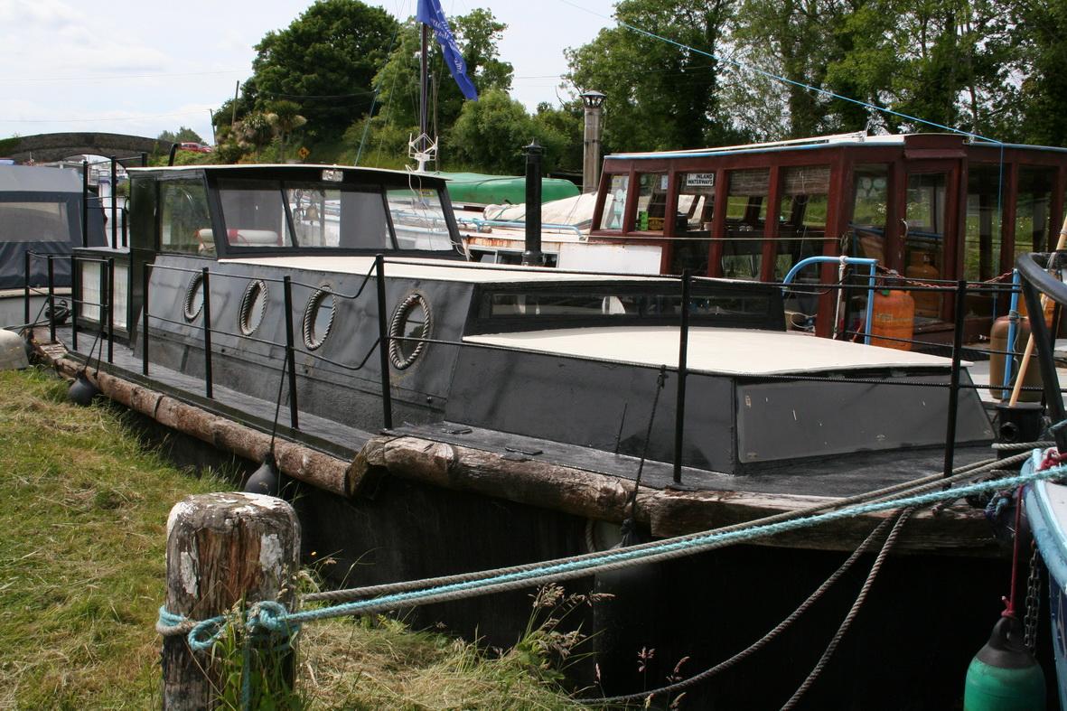 Black boat at Shannon Harbour