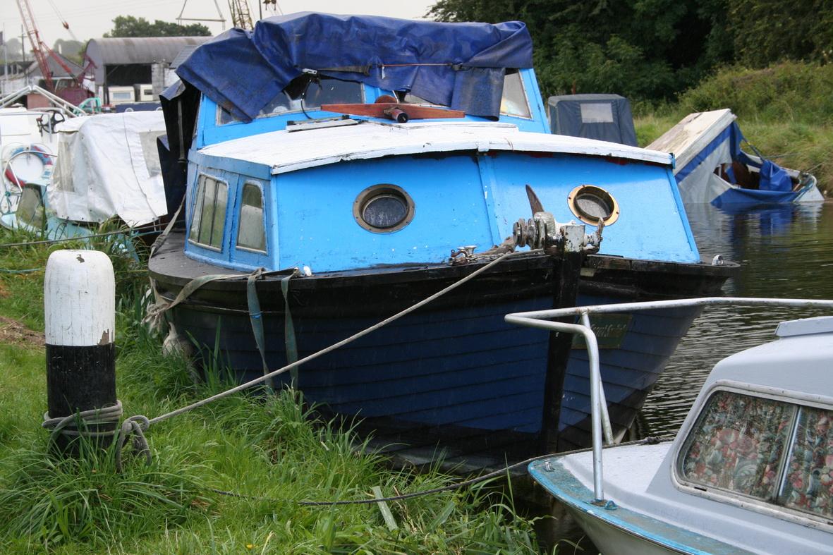 Blue boat afloat