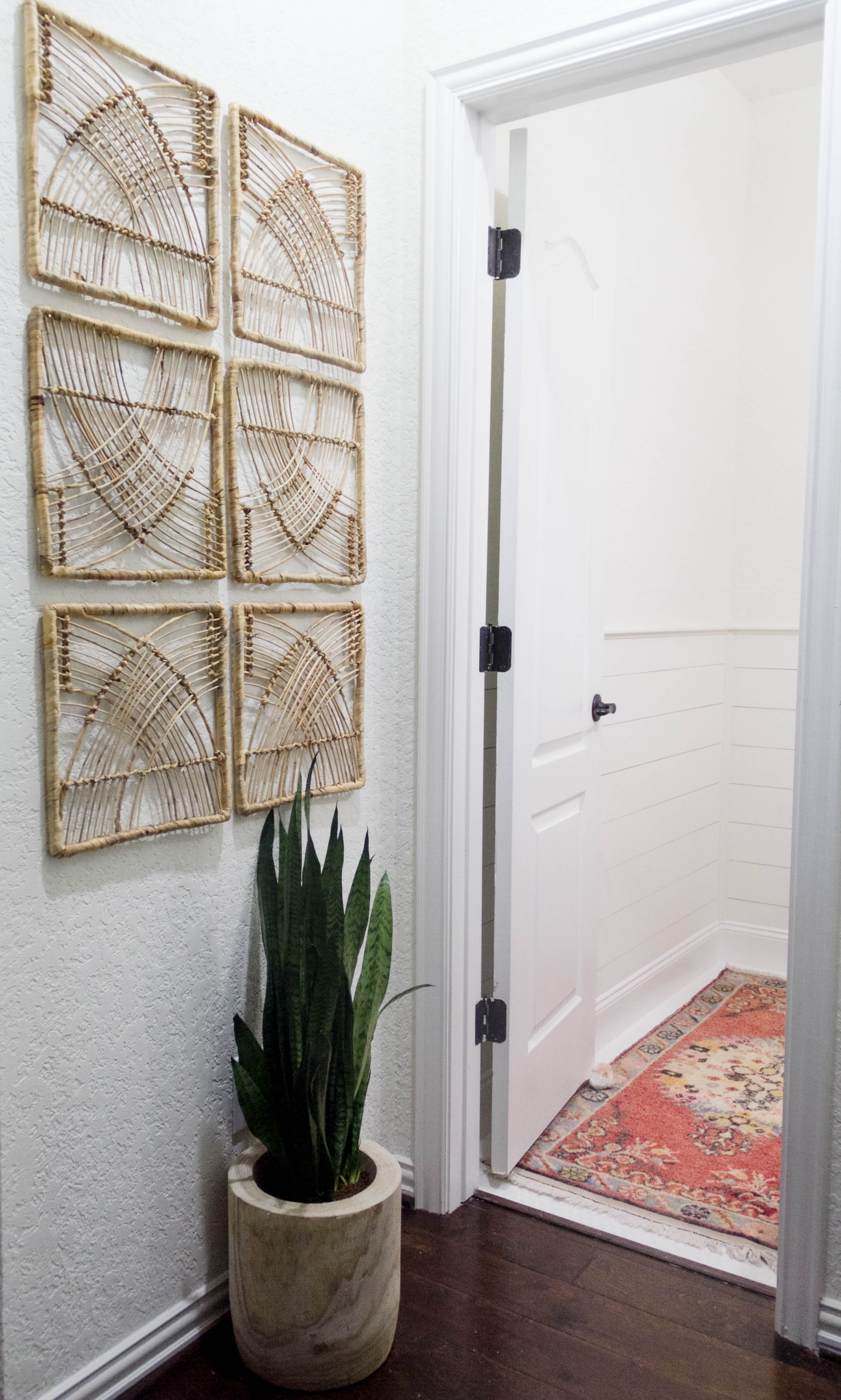 Art wall in a bright and welcoming mudroom/powder room combo with a modern-casual-beach feel. Designed by: IrisNacole.com