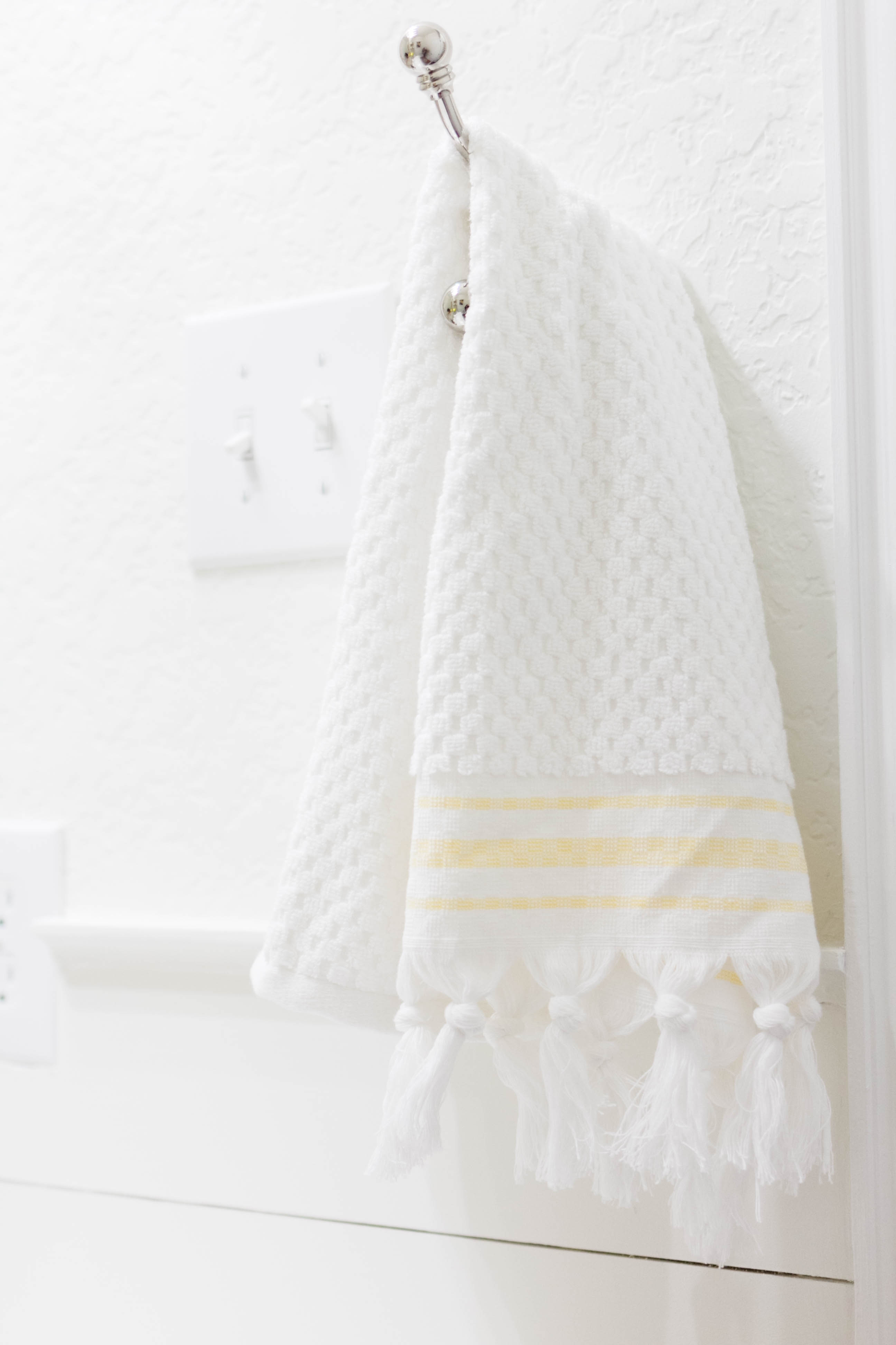 Hand Towel in a bright and welcoming mudroom/powder room combo with a modern-casual-beach feel. Designed by: IrisNacole.com