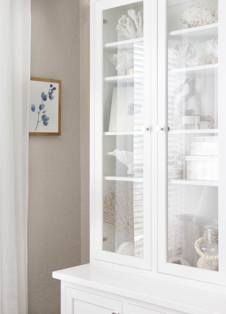 Elegant Coastal Bookcase Styling by Iris Nacole