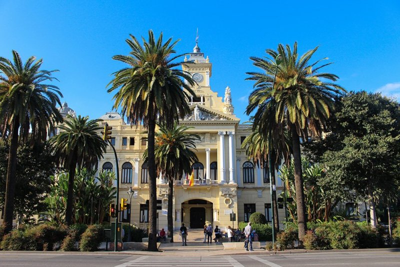 A 2-weeks DIY tour: Andalusia itinerary by bus | City hall in the park in Malaga