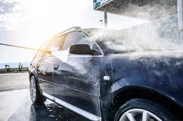 High-pressure washing car outdoors