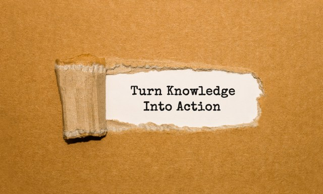 The text Turn Knowledge Into Action appearing behind torn brown paper