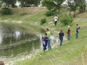 Iron Horse Country Ranch campers fishing on pond