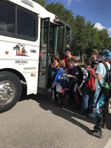Summer Campers loading onto Iron Horse Bus