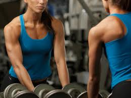 high protein diet plan  -female weight lifter with blue top