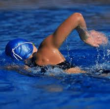 triathlon swim coach -female triathlete swimming in pool