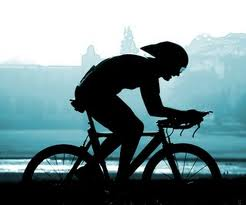 silouette of a triathlete on a triathlon bike