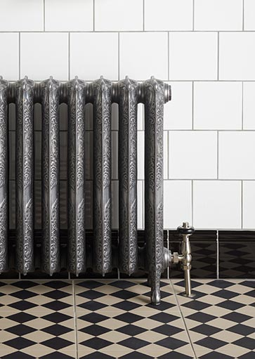 Ironworks Radiators Inc. Castrads Rococo situated in tiled room