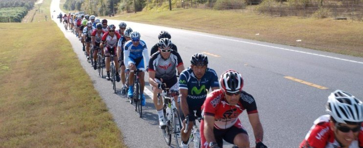 cyclists riding on road at velocious cycling camp in Clermont Florida