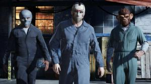 Main characters Franklin, Michael, and Trevor prepare for a heist by purchasing masks.