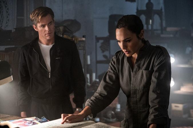 "(L-r) CHRIS PINE as Steve Trevor and GAL GADOT as Wonder Woman in Warner Bros. Pictures' action adventure ""WONDER WOMAN 1984"""