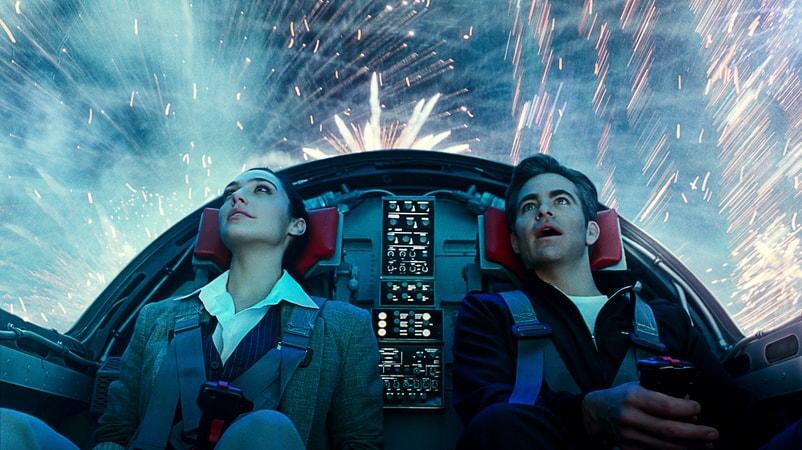 "CHRIS PINE as Steve Trevor and GAL GADOT as Wonder Woman in Warner Bros. Pictures' action adventure ""WONDER WOMAN 1984"""