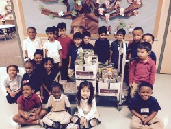 Elementary Pre K Students with their food drive