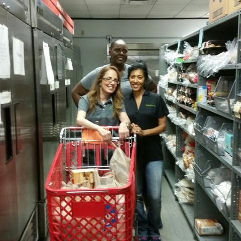 Humana Pharmacy Volunteers with food basket