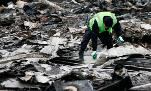 A Dutch investigator works at the site where the downed Malaysia Airlines flight MH17 crashed, near the village of Hrabove (Grabovo) in Donetsk