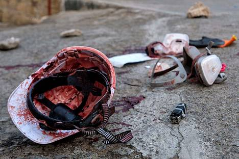 On the streets of Taunggyi on Saturday, a protester demanding democracy was left behind by a bloody helmet.  There is no information on the fate of the helmet owner.
