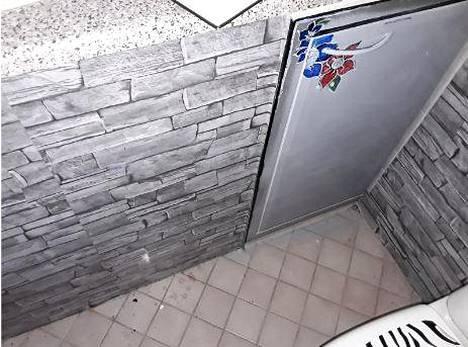 Art in the bathroom cabinet door.