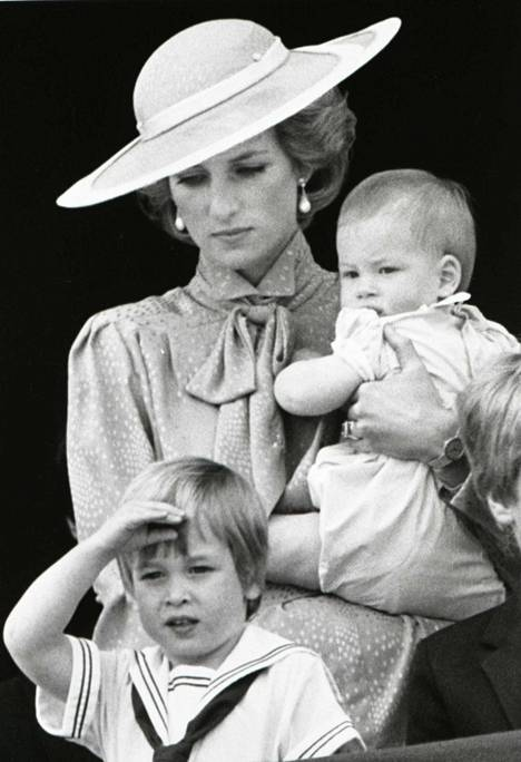 Princess Diana is said to have believed that Prince Charles had a relationship with the family's babysitter.  Pictured are Diana, Harry and William in 1985.