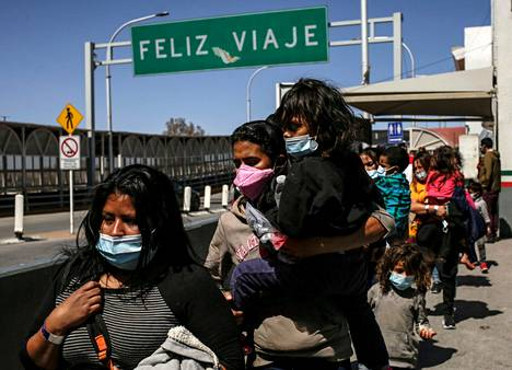 Immigrants deported from the United States walking to Mexico.  According to Biden, families and adult immigrants will be turned away.