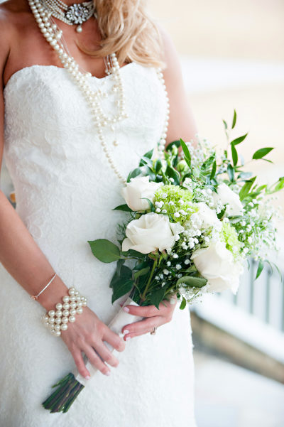 Bride wearing layered necklaces of pearls of different lengths