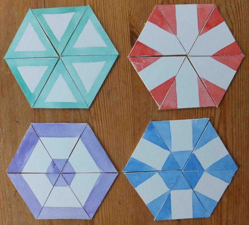 Four ways of producing pattern from a triangular fold