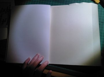 blank notebook and backside of folder