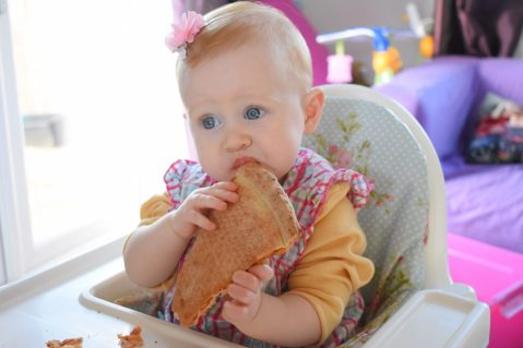NationalPizzaDay 2018 with a baby eating pizza
