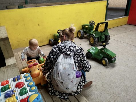 The smaller indoor play area with rideable tractors at Walnut Tree Farm Park
