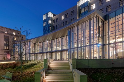 MIT Sloan main building and GMAT scores for top business schools