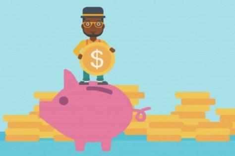 Man standing on a piggy bank holding money