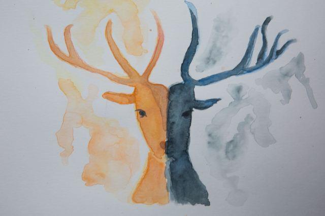 orange and black watercolor of a deer head